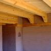 Beams over corbels with wood bond beam.   Home by Win DeLapp