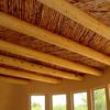 Built By Rachel Matthew Homes Hand peeled vigas with two-tone latilla ceiling.
