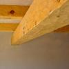 Hand Adzed beams with plaster ceiling.