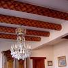 Built by Charlie Mallory Hand carved basket weave vigas with plaster ceiling.