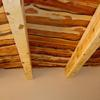 Hand distressed ponderosa pine beams with rough sawn cedar ceiling.